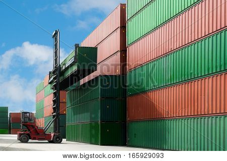 Crane lift up container box loading to container depot use for cargo import export logistics background.