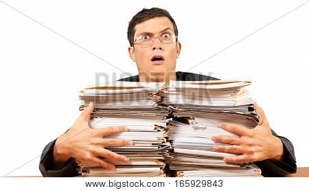 Portrait of a Shocked Employee Behind a Stack of Documents