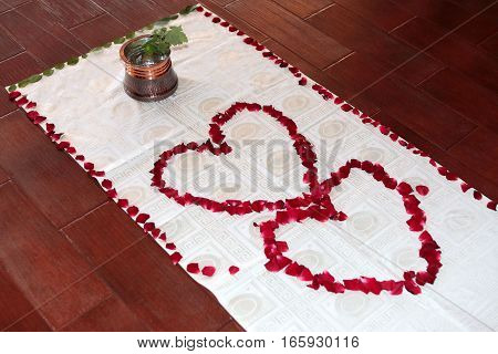 leaves of roses in the shape of hearts
