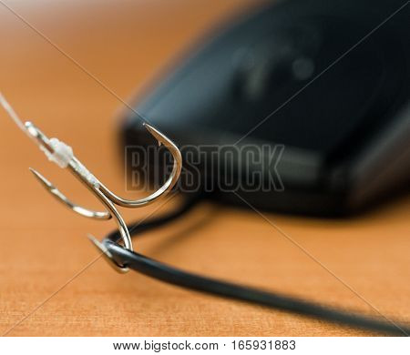 Closeup of a Fishing Hook on Computer Mouse