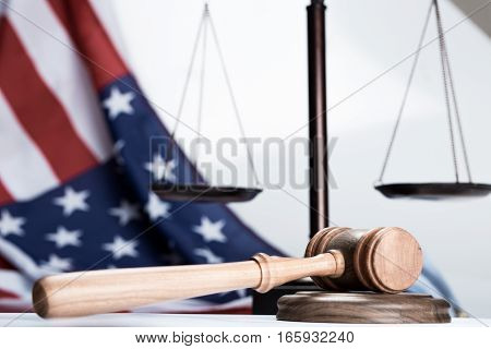 Gavel with Scale and American Flag on Background