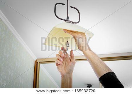Man Installing A Bulb