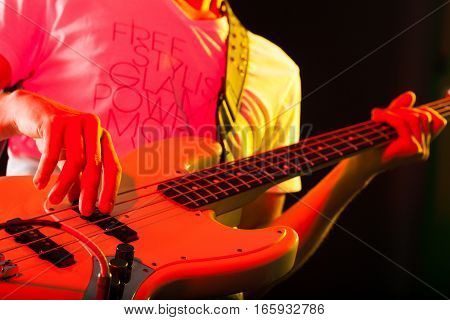 Closeup of a Musician Playing an Electric Bass