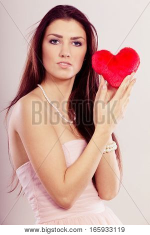 Beautiful Woman Holds Red Heart