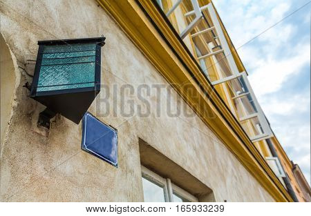 Closeup of Windows and Lamp in a Building