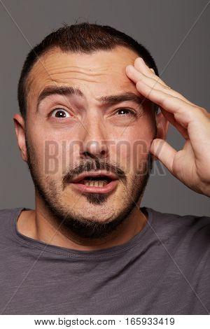Portrait of thinking man shot in studio