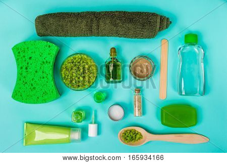 Spa set: soap, mask, oil, sea salt and towel. Top view Still life