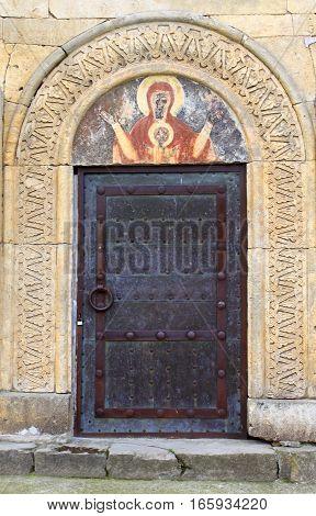 Door and fresco at old orthodox monastery Gelati, near Kutaisi