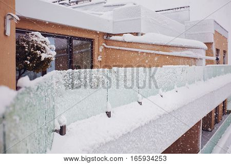 heavy snowfall covered with snow the living block building