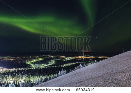 green aurora borealis in Levi ski resort, Finland