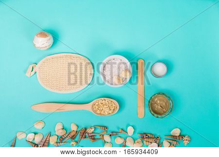 Spa sea salt, shells on blue background. top view. still life. Copy space
