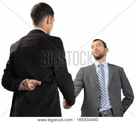 Portrait of Two Businessmen Shaking Hands while Crossing Fingers Behind Back