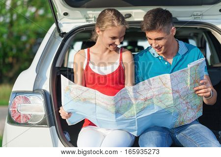 Portrait of Young Couple Looking For Directions On the Map