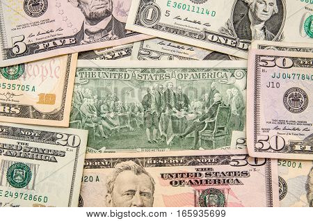 Two dollar bill as background. business concept