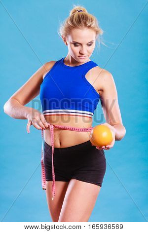 Woman Fit Girl With Measure Tape And Grapefruit