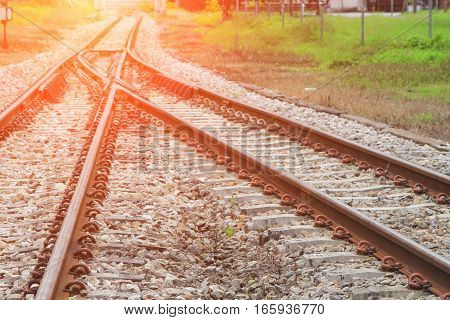railway track on gravel for train transportation with sunset light tone