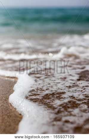 Closeup of Wave of the Sea on a Beach