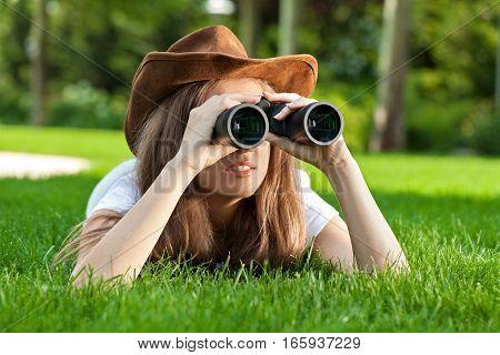 Portrait of a Woman Using Binoculars in a Park