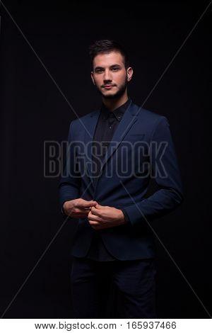 Man Buttoning Jacket Suit