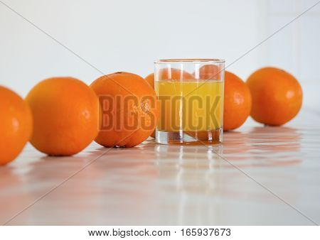 oranges and juice on a white background