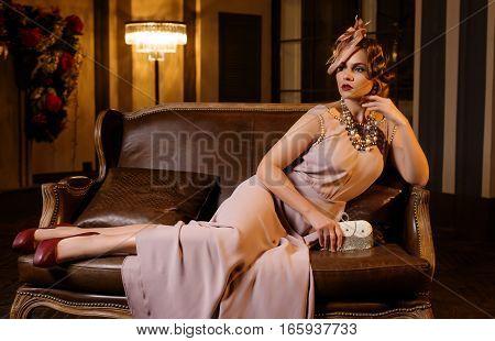 Young beautiful woman in long silk dress