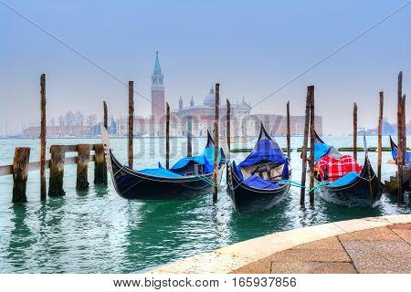 Gondolas on the famous Grand Canal near Santa Maria Cathedral in summer season, in Venice - Italy