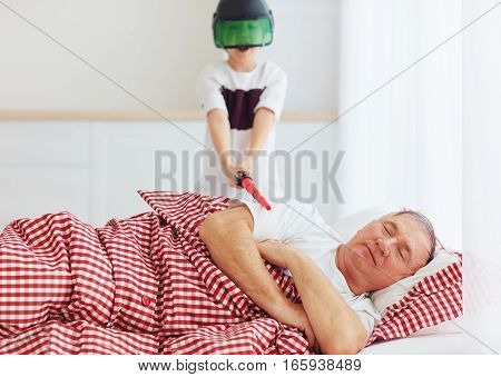 Naughty Yelling Grandson Waking Grandpa Up By Playing Around In Loud, Noisy Games