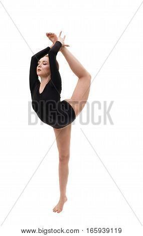 Young blonde girl in black sportsuit exercising studio portrait