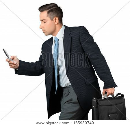 Portrait of a Businessman with Briefcase Using Smartphone