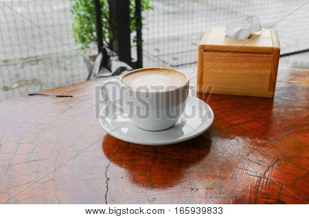 coffee cappuccino close up on wood background