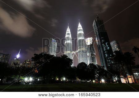 KUALA LUMPUR MALAYSIA-December 31 2016 -Petronas Twin Tower the iconic landmark building on New Year's Eve. The world's tallest twin tower building.