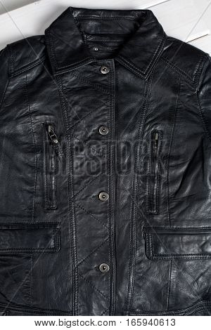 Black leather jacket. Leather jacket macro details. Jacket zippers and pockets
