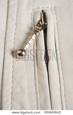 White leather jacket zipper. Macro leather jacket zipper and details