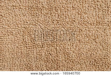 Texture of a fleecy carpet of beige color. The seamless background