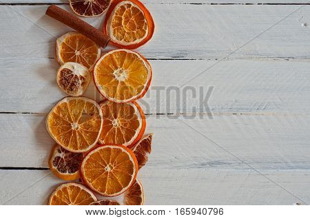 slices of orange on a white wooden surface empty space on the right