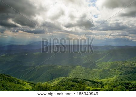 On the high peak mountain landscape on cloudy day.