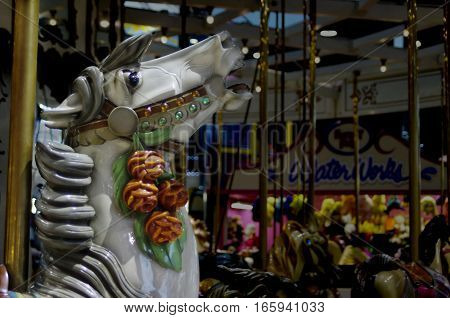 Gray carved carousel horse's head on merry-go-round
