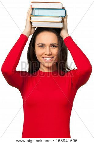 Young woman balancing textbooks on top of her head