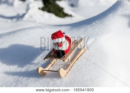 Santa Claus is driving down the mountain