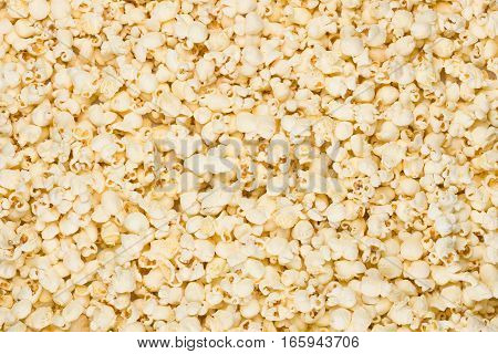 Scattered salted popcorn texture background. Square format