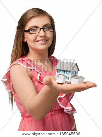 Smiling young woman holding a miniature house in her hand