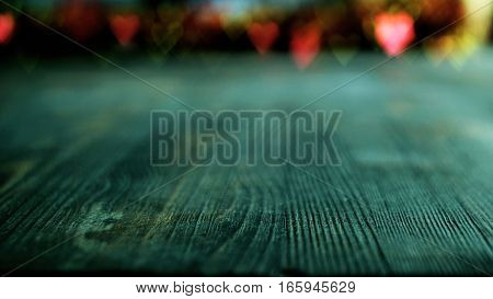 Valentine's day concept with variegated heart bokeh on blue wooden background