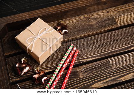 Rustic wooden box with New Year decorations. Christmas preparation concept. Copy space