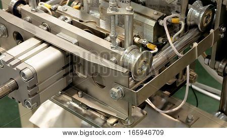 Factory packaging machine with motor rolls and robotics automation. Automatic lines are used instead of human labor on factories and plants.