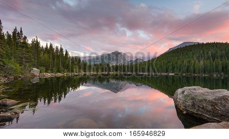 Longs Peak reflection in Bear Lake at dusk, in Rocky Mountain National Park, near Estes Park, Colorado.