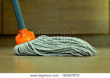 closeup of cleaning the ceramic floor with a mop