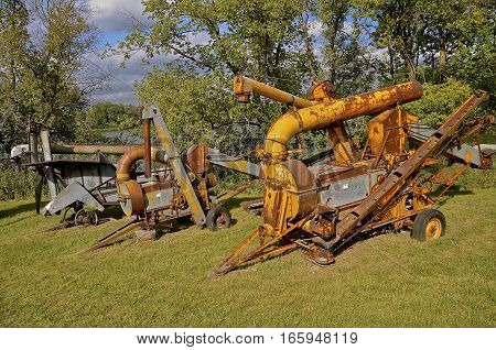 ROLLAG, MINNESOTA, Sept 1. 2016: The old rusty Minneapolis Moline corn sheller, is displayed at the West Central Steam Threshers Reunion in Rollag, MN attended by 1000's held annually on Labor Day weekend.