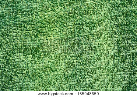 green texture of a fluffy towel for your design