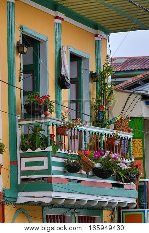 September 22, 2016 FIlandia, Colombia: colonial style balcony decorated with blooming flowers in the coffee producing town