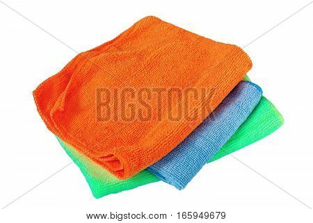 stack of three towels isolated over white background ( orange blue green )